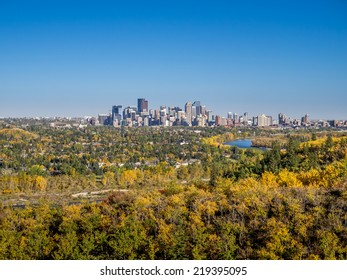 Bow river valley in Calgary, Alberta during autumn. Shot is taken in Edowrthy Park. Urban centre visible in the distance.