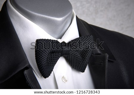5b8e120c3e4 the bow tie on a mannequin in combination with a white shirt and jacket