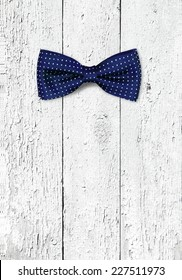bow tie on wooden texture