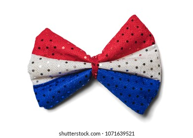 Bow tie with sequins in American flag colors red, white and blue isolated on a white background