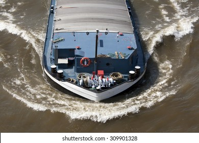 Bow wave of a barge on the river