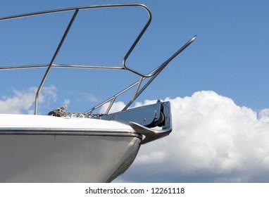 Bow of yacht against blue sky