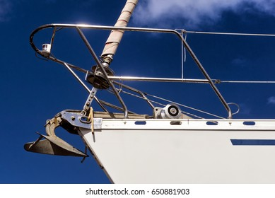 Bow of yacht; detail of white luxury yacht with chrome sparkling in summer sun; blank to add your own name