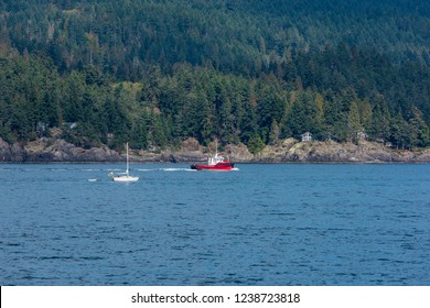 Bowen Island, British Columbia/Canada - September 19, 2018: The Renegade tugboat off the coast of Vancouver is stationed in Port McNeil & assists in docking gravel ships for Standard Towing limited.