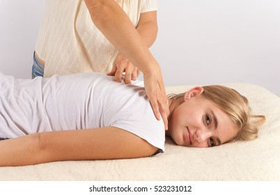 Bowen massage therapy of a young woman
