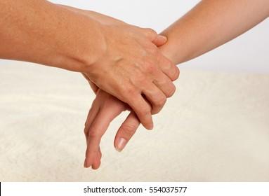 Bowen massage treatment of a hand.