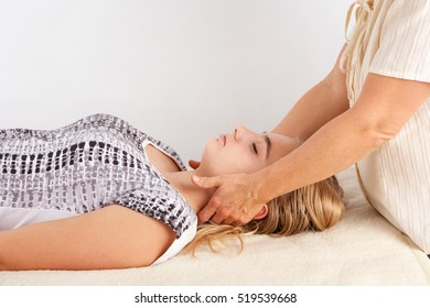 Bowen treatment of a young woman's head. The bowen therapy is a holistic system of healing.