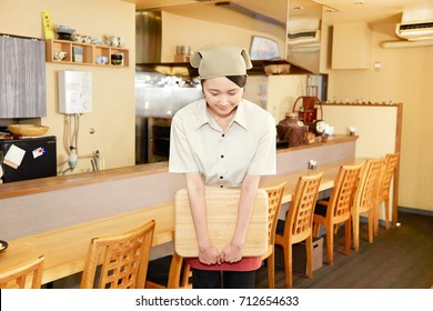 bowing Asian woman