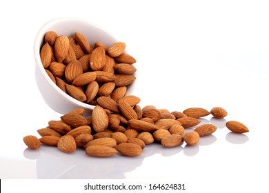 Bowl of almonds isolated on white background