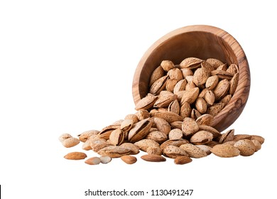 Bowl of almonds on white. Almond nuts with shell in a wood bowl Isolated on white background.