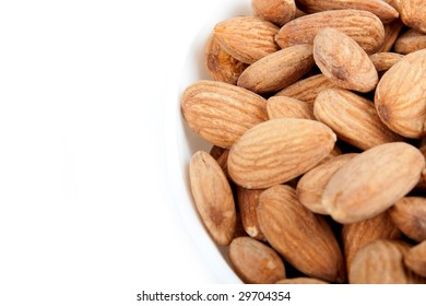 Bowl with almonds on a white background.