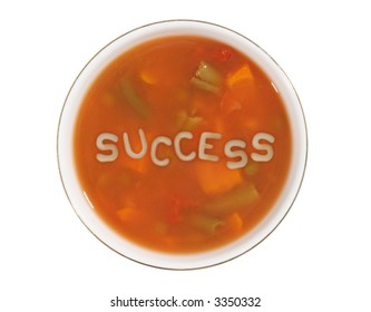 A bowl of alphabet soup with the word success in the middle