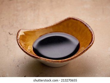 bowl of balsamic vinegar cream on kitchen table