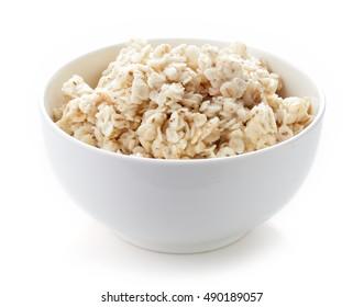 Bowl of barley porridge isolated on white background