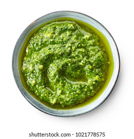 bowl of basil pesto isolated on white background, top view