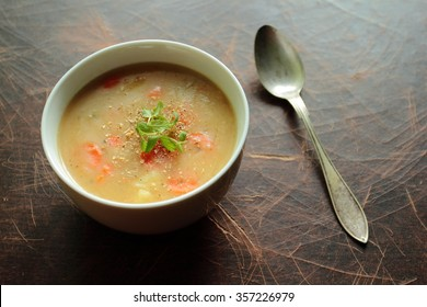 Bowl with bean soup and fresh herbs
