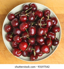 Bowl of black cherries viewed from above