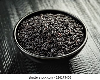 bowl of black rice on black wooden table