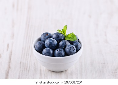 bowl with blueberries isolated on a white background