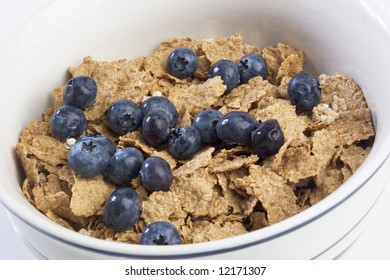 Bowl of breakfast cereal with blueberries