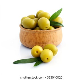 Bowl of brine cured green olives isolated over white