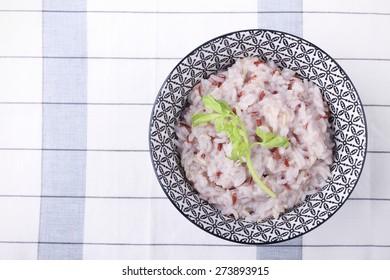 Bowl of brown long grain porridge