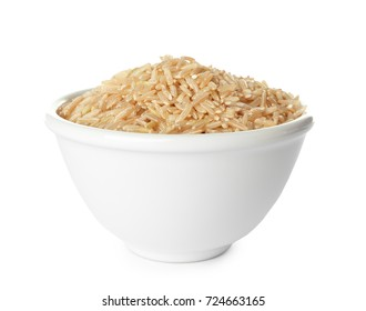 Bowl with brown rice on white background