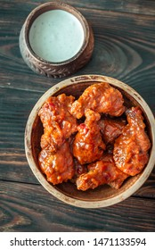 Bowl of buffalo wings with blue cheese dip: top view