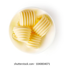 Bowl of butter curls isolated on white background, top view
