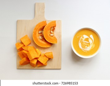 Bowl of butternut squash soup on a white background,isolated,squash soup,top view