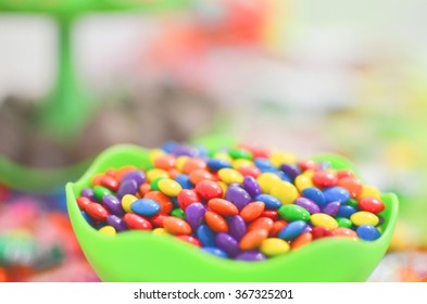 bowl of candy colored with big blur