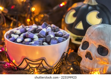 Bowl of candy corn in a dimly lit spooky Halloween theme