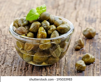 bowl of capers on wooden table