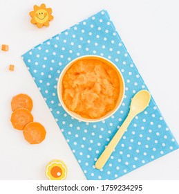 Bowl with carrot puree for baby - Shutterstock ID 1759234295