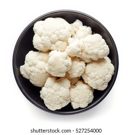Bowl of cauliflower isolated on white background, top view