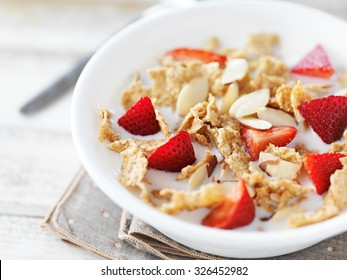 bowl of cereal with strawberries and almonds