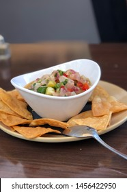 Bowl of ceviche with plate of chips