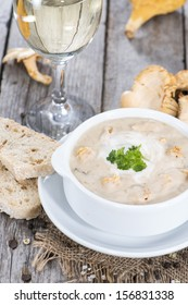 Bowl with Chanterelle Cream Soup and fresh herbs