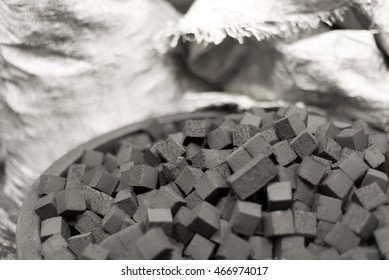 Bowl of charcoal cubes for hookah with bags