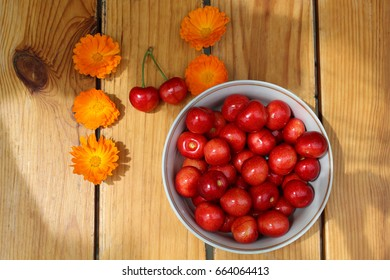 bowl with cherries on a wooden table