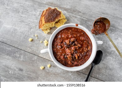 bowl of chili with black beans and cornbread flat lay