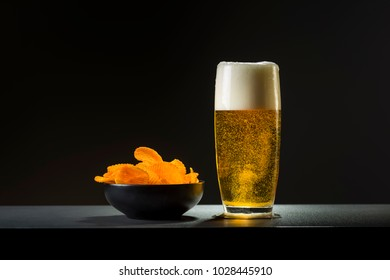 a bowl of chips and beer