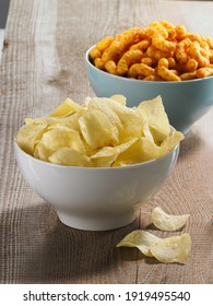 bowl with chips on wooden background