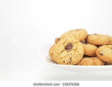 bowl of chocolate chip cookies on white background
