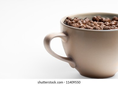 A bowl of chocolate flakes with milk. Very healthy.
