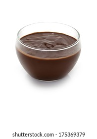 a bowl of chocolate milk cream on a white background