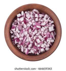 Bowl of chopped red onion on white background. Top view.