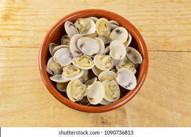 bowl with clams on a rustic table