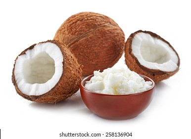 bowl of coconut oil and fresh coconuts isolated on white