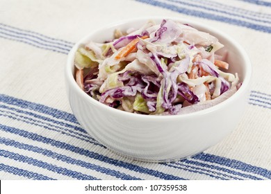 bowl of coleslaw salad - side dish on a tablecloth